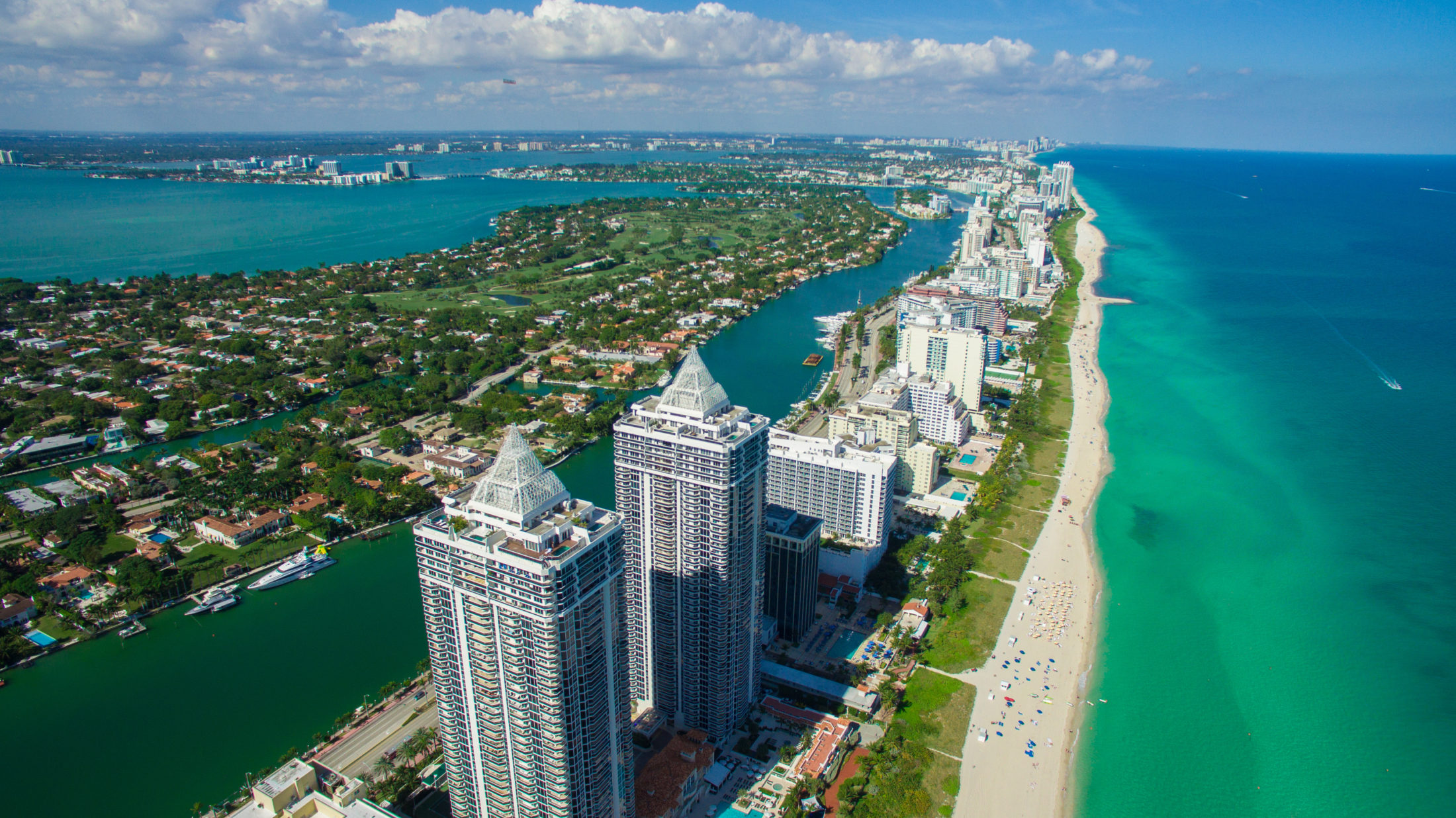 Mid Beach As Its Name Sounds Is Situated Between North And South Luxury Condo Buildingimo Miami Modern Hotels Line The Ss
